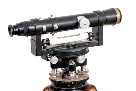 tachymeter: vintage theodolite over white background surveyor level equipment 1960 Stock Photo