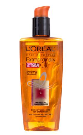 penetrating: Sorel-Tracy, Canada - January 21, 2016: LOréal paris penetrating oil hair care bottle 100ml over white background