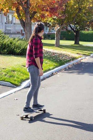 25 29 years: women riding longboard skateboard outdoor at daytime at fall in quebec province canada