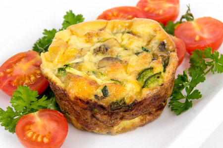 egg muffin cup dinner quiche and omelet style with mushroom spinach and pepper Archivio Fotografico