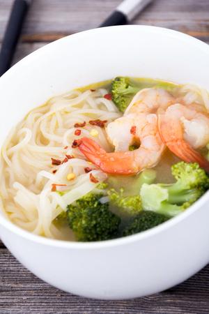 vietnamese ethnicity: asian prawn rice noodle soup closeup on rustic table