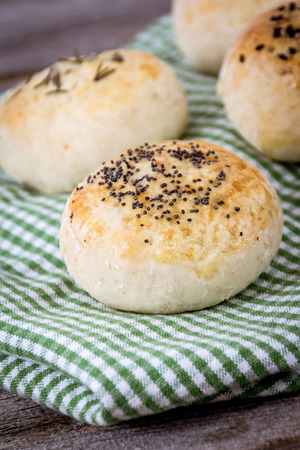 bread roll: fresh rustic homemade bread roll on table