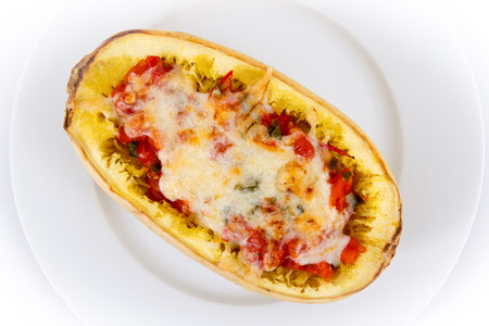 tomato and cheese stuffed spaghetti squash Stock Photo