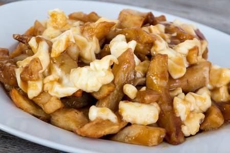 Poutine quebec meal with french fries, gravy and cheese curds