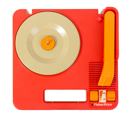 Sorel-Tracy, Canada - April 30, 2017 : Vintage Fisher Price Record Player portable Portable Gramophone Toy #820 from 1983. Studio shot over white background.