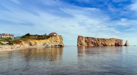 Perce, Canada-11 August 2017 : View of Perce Rock at summer. Perce Rock is a huge sheer rock formation in the Gulf of Saint Lawrence on the tip of the Gaspe Peninsula in Quebec, Canada, off Perce Bay.