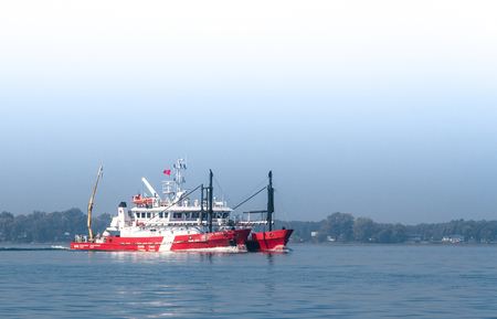 Sorel-Tracy, Canada-09 September 2017 : CCGS F.C.G. Smith is a small twin-hull sounding vessel designed to conduct depth survey operations of the main shipping channel in the St-Lawrence River