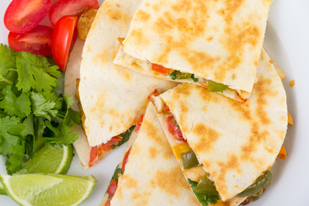 Chicken quesadilla dish on wooden rustic table Stock Photo