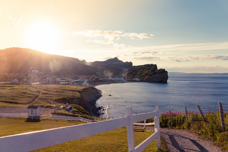 View of Perce village in Quebec Canada at sunset from a pedestrial trail Archivio Fotografico