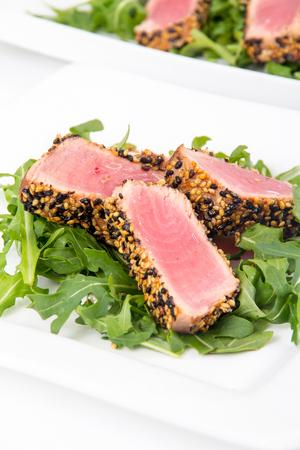 tuna tataki sesame crust appetizer plate over wood backgroung Stock Photo
