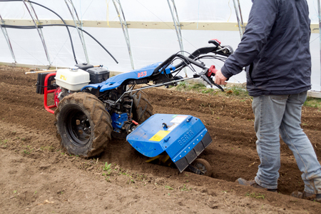 Quebec, Canada-29 April 2018 : BCS 853 13 HP is a popular tractor unit preparing soil inside green house at spring. Editorial
