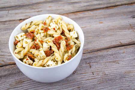 Sundried tomato and pesto pasta salad with feta cheese