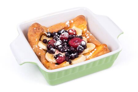 dutch German pancake topped with bluberries berries fruit and banana breakfast over white background Фото со стока