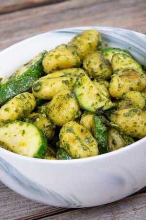 potato gnocchi pasta with zucchinis and fresh homemade basil pesto bowl Reklamní fotografie