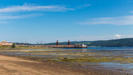 view of La baie city  Port-Alfred's facilities in Ha! HA! Bay Saguenay Quebec Canada at low tide Imagens