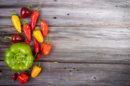 mix pepper variety harvest on a rustic wood table high angle view