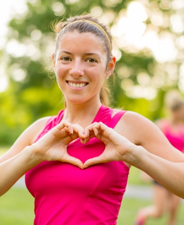 Portrait attractive girl talking care of her health and heat by jogging photo