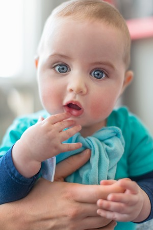 Adorable toddler with a confused and curious look on his face photo