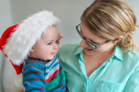 Adorable toddler and mother bonding at Christmas time photo