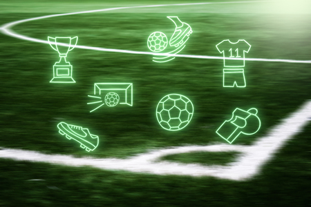 Football arena. Trophy, goalie, soccer ball, fotball shirt on a blurred futball field background