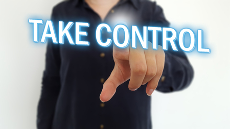 Businesswoman pointing fingers on take control text