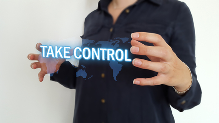 Businesswoman using take control hologram text