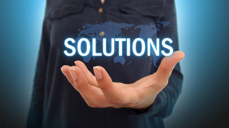 Businesswoman holding solutions over world map hologram Фото со стока