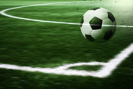 Soccer ball has a blurred World Cup football field background. Achieve a victory