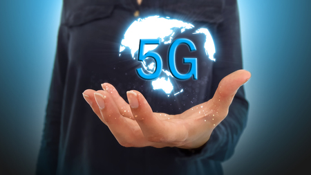 Businesswoman on a blurred background using 5G network interface Stock Photo