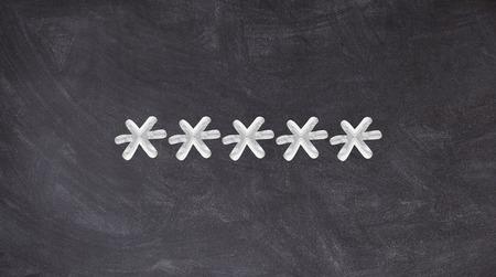 Several asterisks written on blackboard