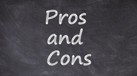 Pros and Cons written on blackboard