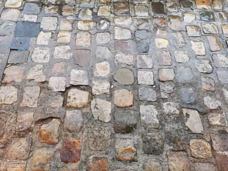 Old cobblestones wet with rain
