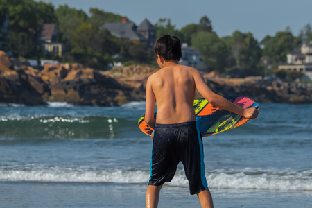 Young man surfing at the beach