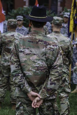 Commander standing from of soldiers Stock Photo