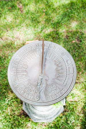 Traditional sundial on grass