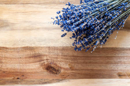 Dried lavender bunch on a wooden background