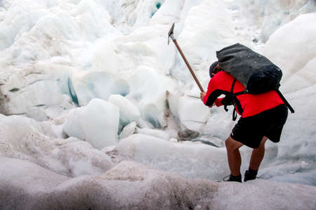 Man hiking on Franz Josef Glacier in New Zealand- 20th of August 2010.