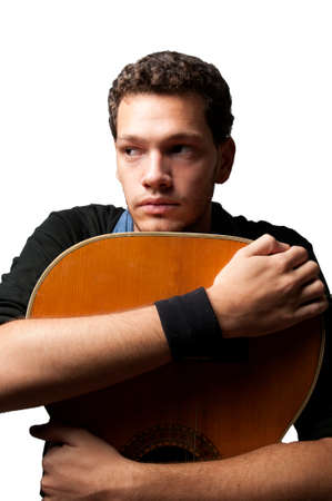 Young man holding a guitar over white background