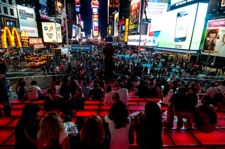 Spectators taking in the splendor of Times Square all lit up at night.  September 25th 2010. Editorial
