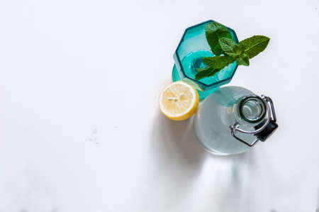 Refreshing bottle of water with lemon and mint Stock Photo