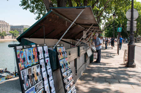 Stands selling books and art along the river Seine in Paris Editorial