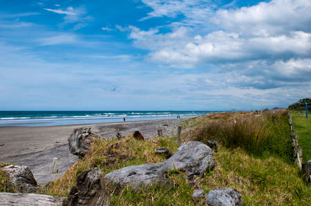 Waihi Beach is a beautiful 9km-long authentic kiwi sandy beach known for its surfing is located in the Bay of Plenty on the north island of New Zealand. Stock Photo