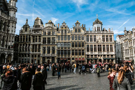 Brussels / Belgium - October 2019: Crowded Grand Place or Grote Markt on a sunny day. Main square in Brussels - a popular landmark with town hall and museums. Historical place where guided tours start