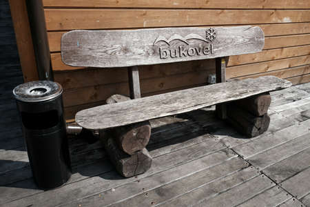 Bukovel, Ukraine - July 2020: Wooden bench with Bukovel logo at a popular ski resort in Ukraine. Summertime activities in the Carpathian mountains. Ukrainians spending summer locally during pandemic.