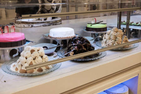 Belek, Turkey - October 2020: Cake selection in an all-inclusive hotel in Antalya. Free sweets included in tour price. Assortment of cakes and pies for hungry tourists. Different delicious flavors. 新闻类图片