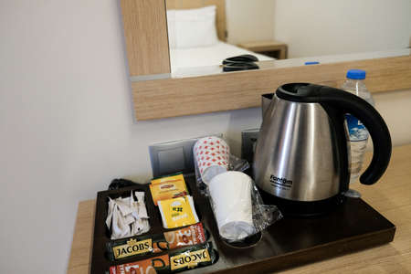 Belek, Turkey - October 2020: Using plastic cups instead of ceramic in hotel room. All inclusive resort with safety measures to prevent epidemic during coronavirus outbreak. Single use cutlery in use.