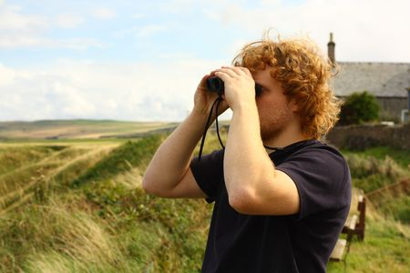 Young man watching birds Stock Photo - 3539414
