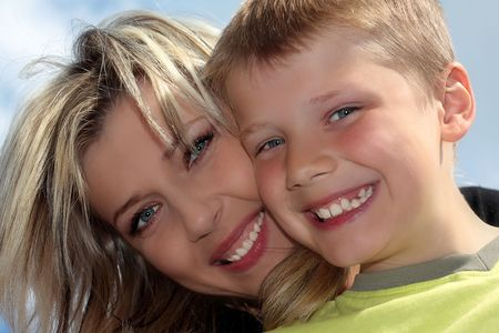 Happy mother and son smiling closeup photo