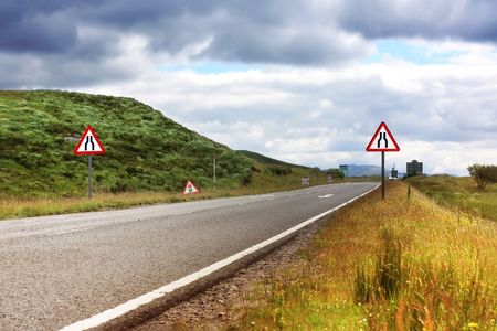 scottish: Road with roaD signs in Scotland, summertime Stock Photo