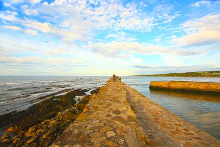 Old Pier in St Andrews, Scotland photo